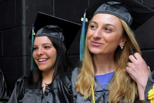 Waiting for the start of graduation ceremonies for Naugatuck Valley Community College Thursday are from left, Erica Atchison, of Naugatuck, Amanda Bachman and Lina Baddour both of Bethel. The ceremony was held at The Palace Theatre in Waterbury, Conn. May 26, 2016.