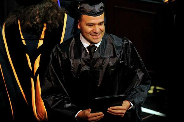 Jose Benitez, 47, of Danbury receives his diploma from Naugatuck Valley Community College Thursday, May 26, 2016, at The Palace Theatre in Waterbury, Conn.