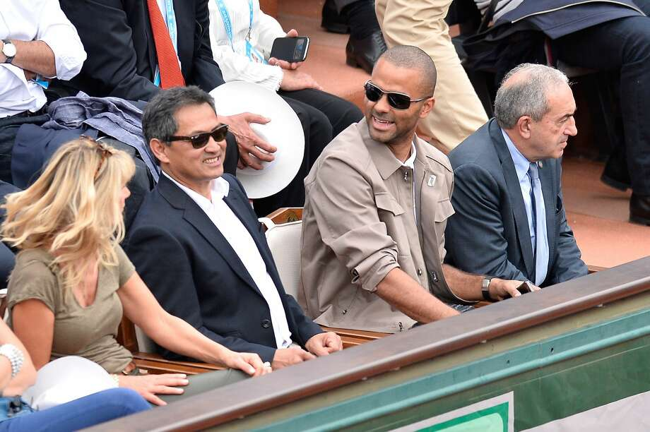 PARIS, FRANCE - MAY 26:  Tony Parker (C) and Jean Gachassin (L) attend the men's single second round match on day five of the 2016 French Open at Roland Garros on May 26, 2016 in Paris, France.  (Photo by Aurelien Meunier/Getty Images) Photo: Getty Images
