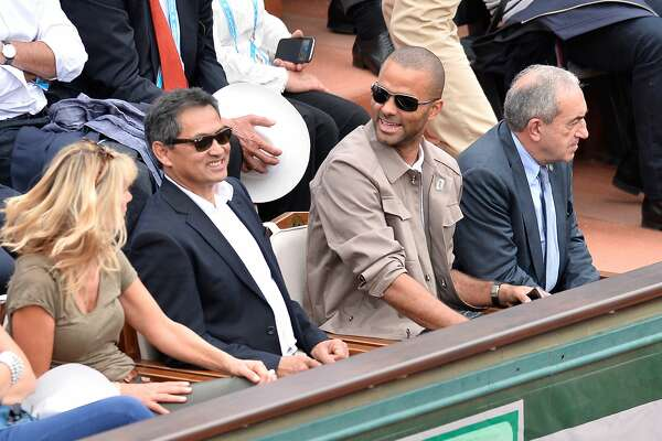 PARIS, FRANCE - MAY 26:  Tony Parker (C) and Jean Gachassin (L) attend the men's single second round match on day five of the 2016 French Open at Roland Garros on May 26, 2016 in Paris, France.  (Photo by Aurelien Meunier/Getty Images)