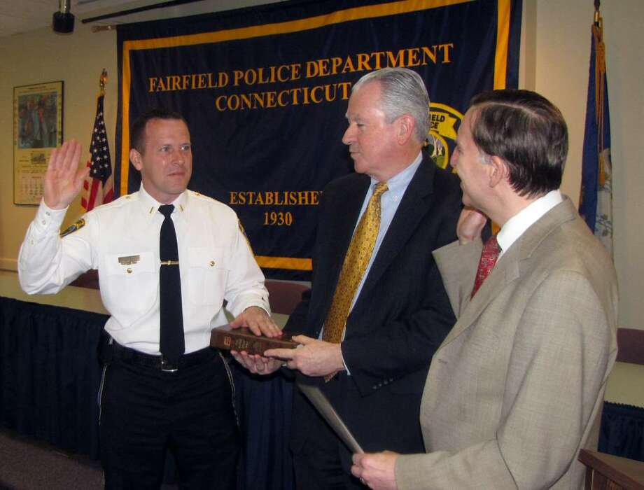 From left, new police Lt. Keith Broderick, Police Commission member William Fitzpatrick and First Selectman Kenneth Flatto at Broderick's swearing in Monday. Photo: Contributed Photo / Connecticut Post Contributed