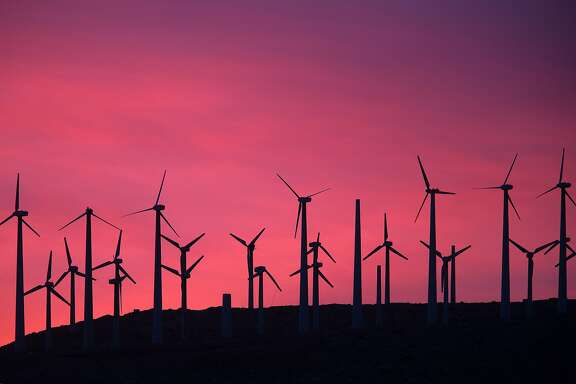 TOPSHOT - Electric energy generating wind turbines are seen on a wind farm in the San Gorgonio Pass area on Earth Day, April 22, 2016, near Palm Springs, California.  San Gorgonio Pass is one of the largest wind farm areas in the United States.  / AFP PHOTO / David McNewDAVID MCNEW/AFP/Getty Images