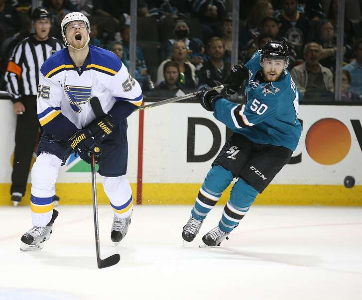 The San Jose Sharks' Chris Tierney (50) battles the St. Louis Blues' Colton Parayko (55) for the puck in the second period during Game 6 of the NHL Western Conference finals at SAP Center in San Jose, Calif., on Wednesday, May 25, 2016. The Sharks advanced, 5-2. (Aric Crabb/Bay Area News Group/TNS)