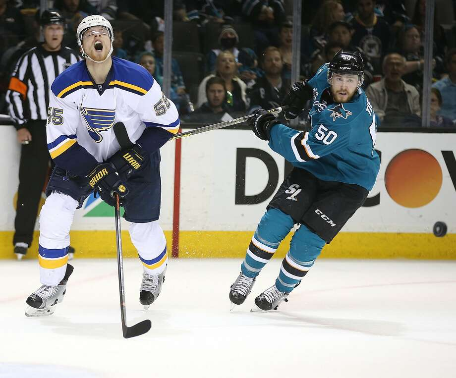 The San Jose Sharks' Chris Tierney (50) battles the St. Louis Blues' Colton Parayko (55) for the puck in the second period during Game 6 of the NHL Western Conference finals at SAP Center in San Jose, Calif., on Wednesday, May 25, 2016. The Sharks advanced, 5-2. (Aric Crabb/Bay Area News Group/TNS) Photo: Aric Crabb, TNS