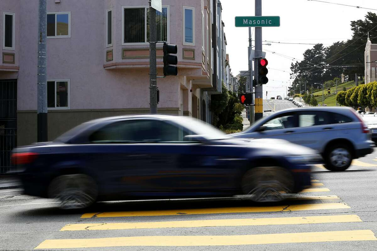 Cars drive on Masonic Avenue between Fell Street and Geary Boulevard in San Francisco, California, on Wednesday, May 25, 2016.