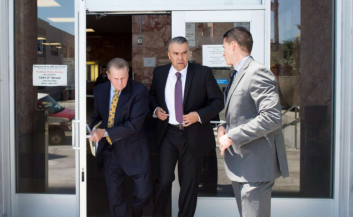 Alameda County sheriff's deputies Luis Santamaria, center, and Paul Wieber, right, leave the Hall of Justice following their arraignment on Thursday, May 26, 2016, in San Francisco. At left is defense attorney Michael Rains. The deputies face felony charges stemming from a video-recorded beating of 29-year-old Stanislav Petrov last November.