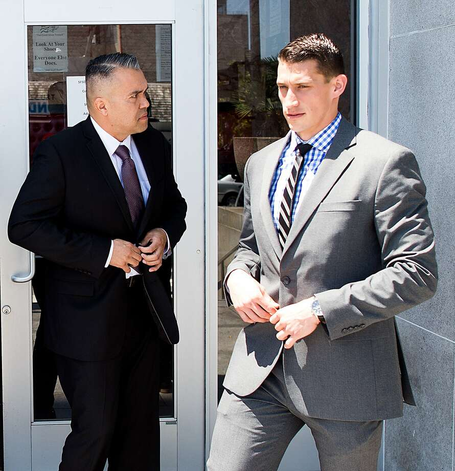 Former Alameda County sheriff's deputies Paul Wieber, right, and Luis Santamaria leave the Hall of Justice following their arraignment on Thursday, May 26, 2016, in San Francisco. The deputies face felony charges stemming from a video-recorded beating of 29-year-old Stanislav Petrov in November 2015. (File photo) Photo: Noah Berger, Special To The Chronicle