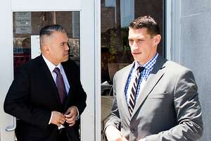 Alameda County sheriff's deputies Paul Wieber, right, and Luis Santamaria leave the Hall of Justice following their arraignment on Thursday, May 26, 2016, in San Francisco. The deputies face felony charges stemming from a video-recorded beating of 29-year-old Stanislav Petrov last November.