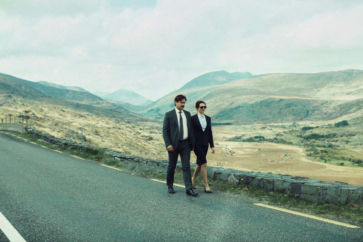 """This image released by A24 Films shows Colin Farrell, left, and Rachel Weisz in a scene from the film, """"The Lobster."""" The movie opens Friday, May 13, 2016. (A24 Films via AP)"""