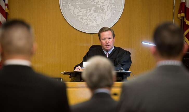 San Francisco County Superior Court Judge Ross Moody presides over a hearing for Alameda County sheriff's deputies Luis Santamaria, left, and Paul Wieber, right, on Thursday, May 26, 2016, in San Francisco. The deputies face felony charges stemming from a video-recorded beating of 29-year-old Stanislav Petrov last November.