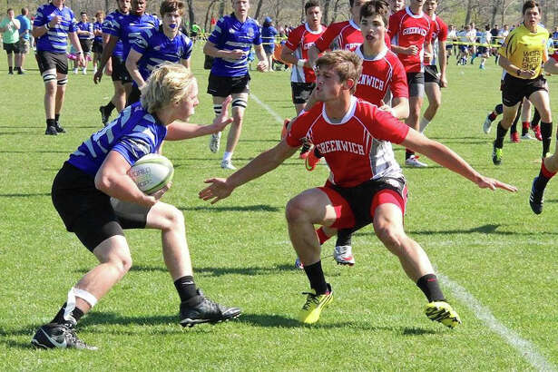 Greenwich's Luke Bienstock defends during The Jesuit Rugby Classic in Virginia in April. Greenwich placed third in the tournament.