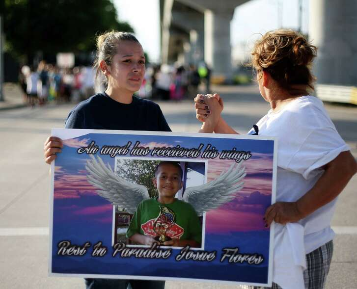 Guadalupe Flores, sister of Josue Flores, starts to become emotional as she holds hands with Consuela Martinez during a march for her brother  on  Sunday, May 22, 2016,  Houston. ( Elizabeth Conley / Houston Chronicle )