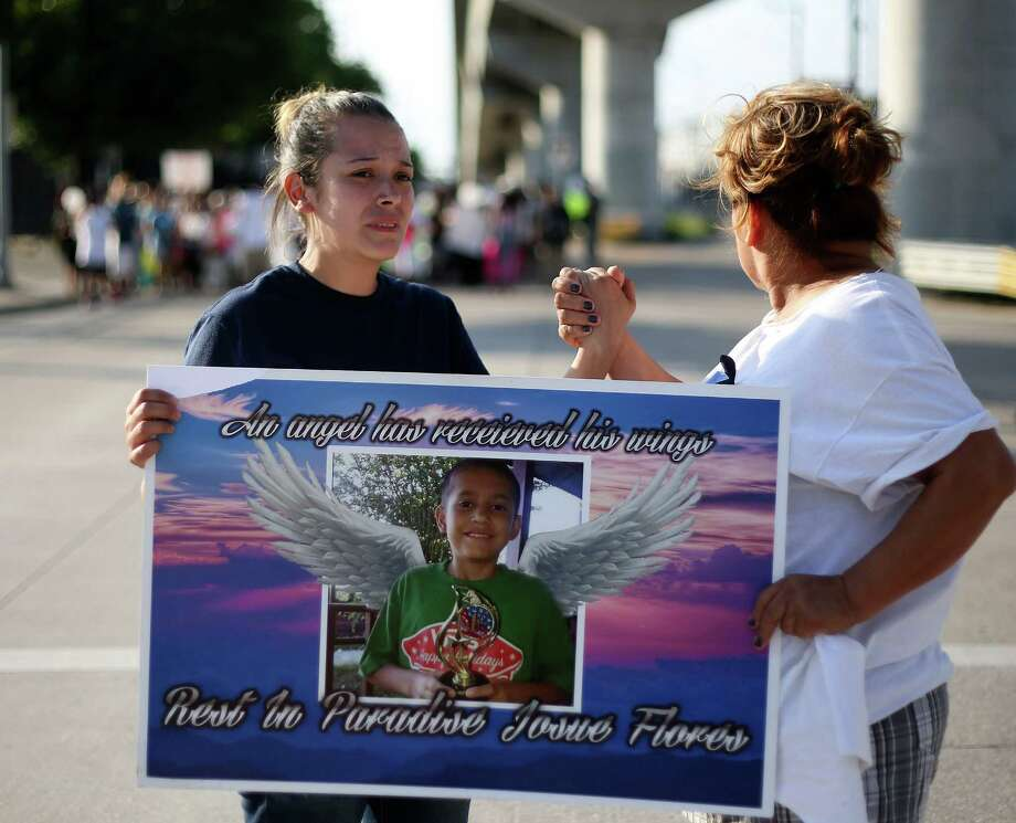 Guadalupe Flores, sister of Josue Flores, starts to become emotional as she holds hands with Consuela Martinez during a march for her brother  on  Sunday, May 22, 2016,  Houston. ( Elizabeth Conley / Houston Chronicle ) Photo: Elizabeth Conley, Staff / © 2016 Houston Chronicle