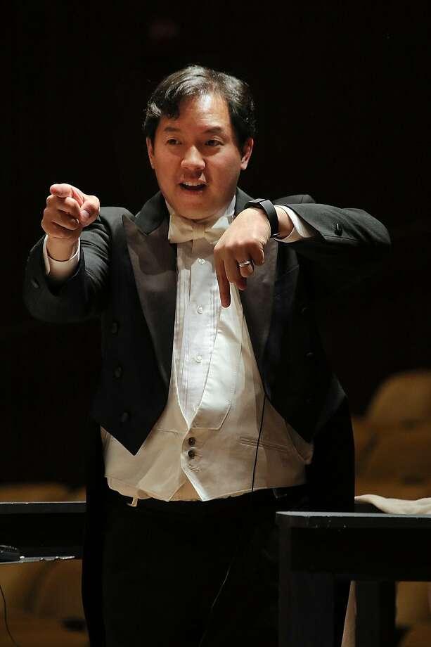 Ming Luke conducts the Berkeley Community Chorus and Orchestra. Photo: Bill Hocker