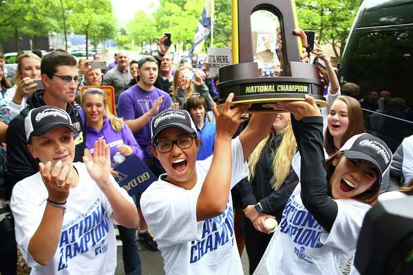 The UW women's golf team celebrates their 2016 NCAA national championship win during a homecoming celebration outside Husky Stadium, Thursday, May 26, 2016.