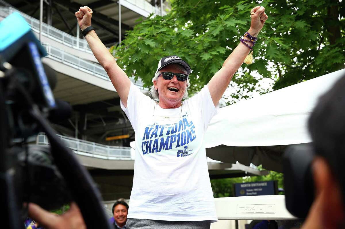 Head coach Mary Lou Muffler celebrates the UW women's golf team's 2016 NCAA national championship win during a homecoming celebration outside Husky Stadium, Thursday, May 26, 2016.