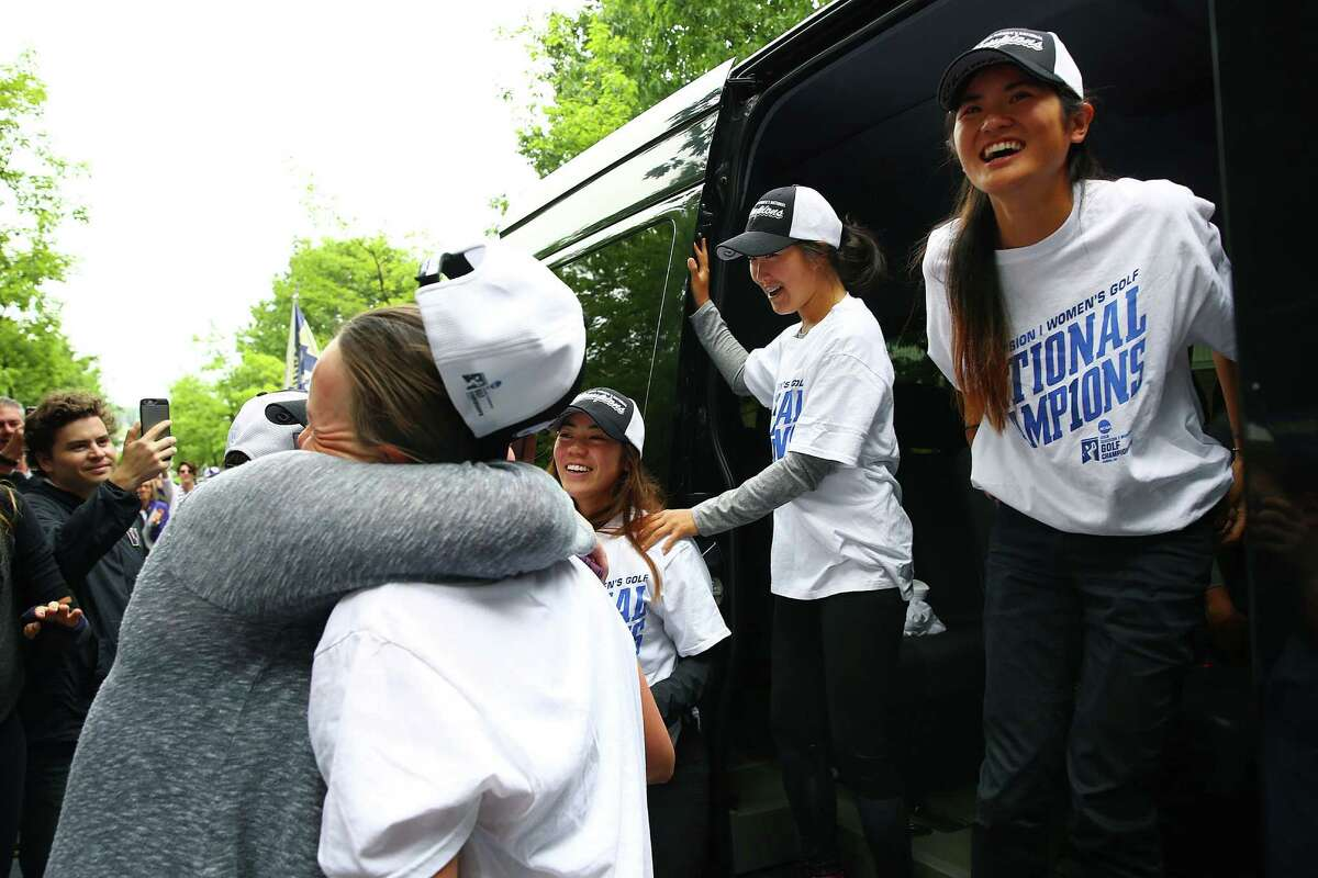 The UW women's golf team arrives to a homecoming celebration outside Husky Stadium after winning the 2016 NCAA national championships, Thursday, May 26, 2016.