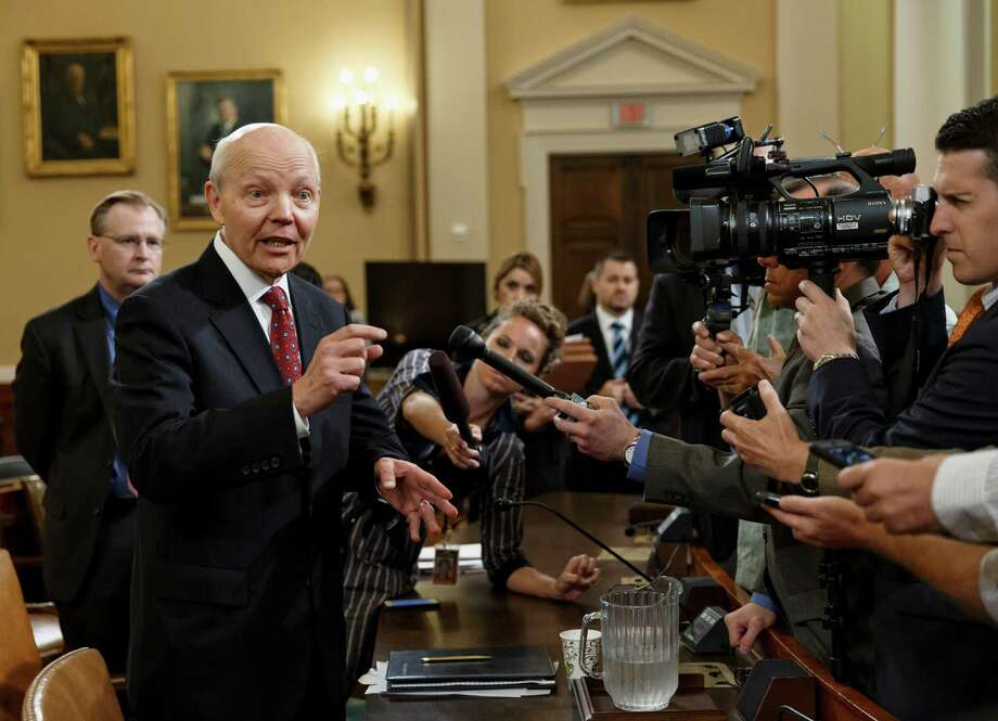 Internal Revenue Service Commissioner John Koskinen talks to reporters during a break in his 2014 appearance before the House Ways and Means Committee hearing on their continuing probe of whether tea party groups were improperly targeted for increased scrutiny by the IRS. (AP Photo/J. Scott Applewhite) Photo: J. Scott Applewhite, STF / AP