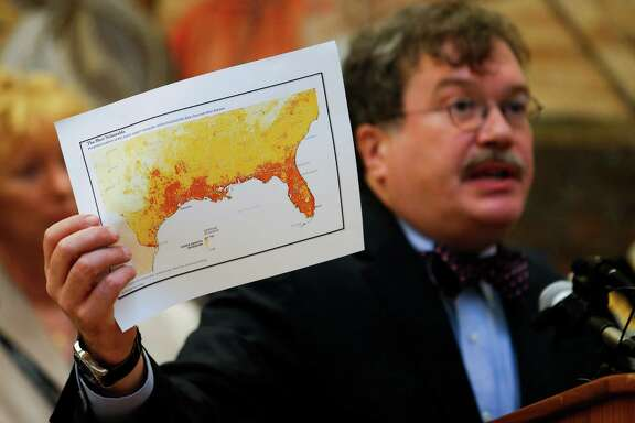 Baylor College of Medicine Dean of the National School of Tropical Medicine holds up a map showing the areas of the United States most vulnerable to the presence of the Aedes aegypti mosquitoes that can transmit Zika virus.  (Michael Ciaglo / Houston Chronicle )