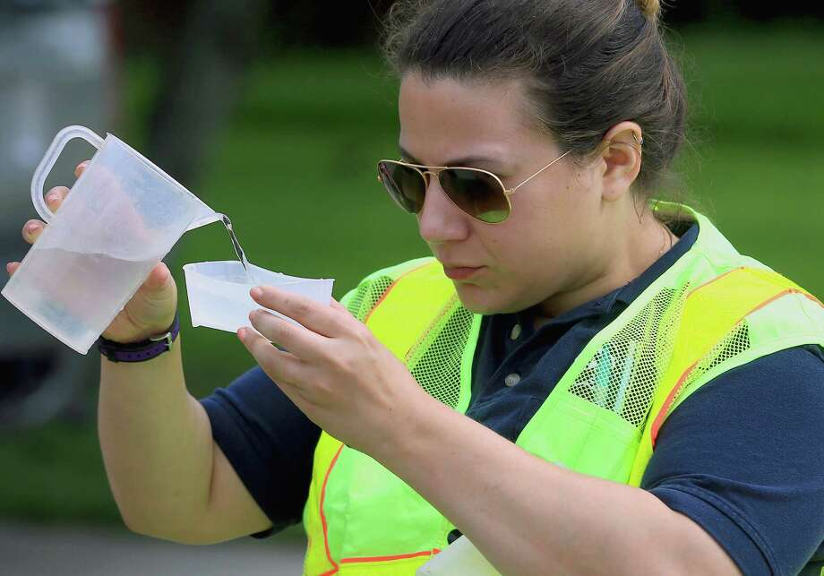 Mouttet from the Corpus Christi Utilities Department collects a sample of water to test Saturday, May 14, 2016, on the corner of Claremore St. and Kentner St. in Corpus Christi, Texas. (AP Photo/Gabe Hernandez, Corpus Christi Caller-Times) Photo: Gabe Hernandez, Photographer / Caller-Times / Caller-Times