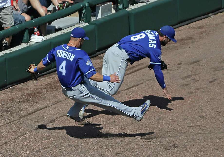 CHICAGO, IL - MAY 22:  Alex Gordon #4 and Mike Moustakas #8 of the Kansas City Royals collide going for a foul ball against the Chicago White Sox at U.S. Cellular Field on May 22, 2016 in Chicago, Illinois. The White Sox defeated the Royals 3-2.  (Photo by Jonathan Daniel/Getty Images) Photo: Jonathan Daniel, Staff / 2016 Getty Images