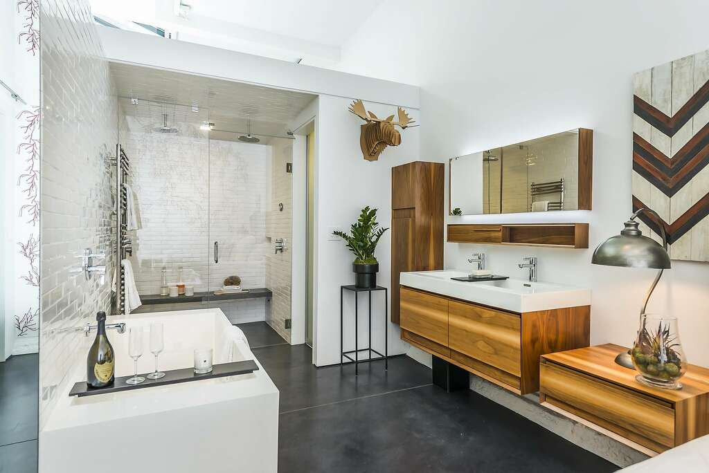 The master suite includes a soaking tub and floating vanity, as well as a rain shower with steam shower capabilities. Photo: Olga Soboleva / Vanguard Properties