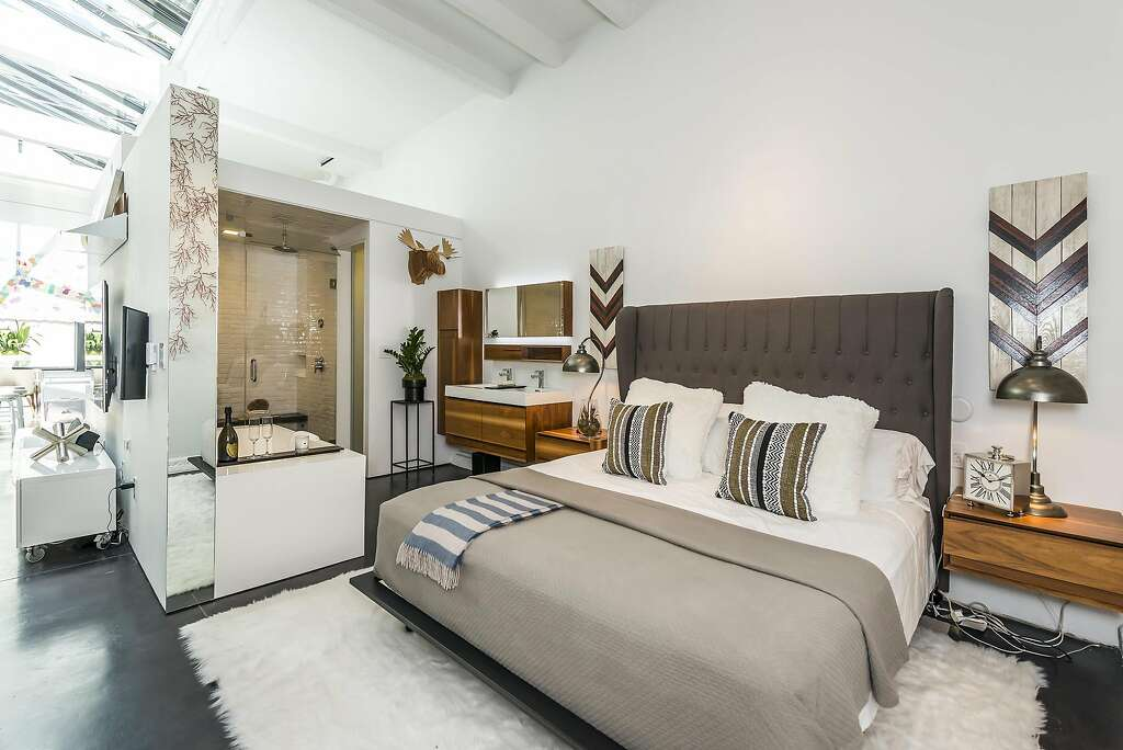 This bedroom off the great room includes an en-suite bath. Photo: Olga Soboleva / Vanguard Properties