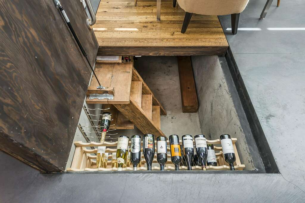 Lifting floorboards in the great room's dining area reveals a wine cellar. Photo: Olga Soboleva / Vanguard Properties