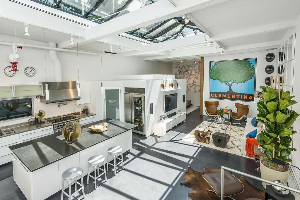 The skylight stretches above the great room, integrating the indoors and out. Photo: Olga Soboleva / Vanguard Properties