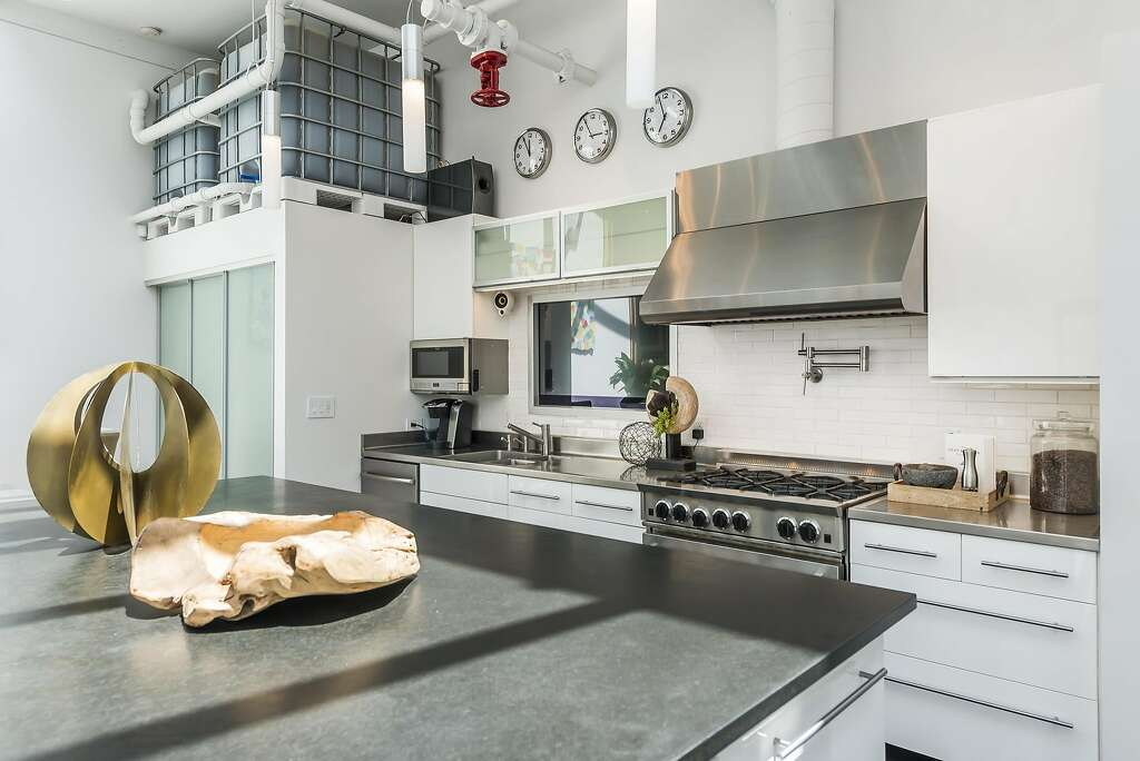 A subway tile backsplash and pot filler rest beneath a restaurant caliber exhaust hood. Photo: Olga Soboleva / Vanguard Properties