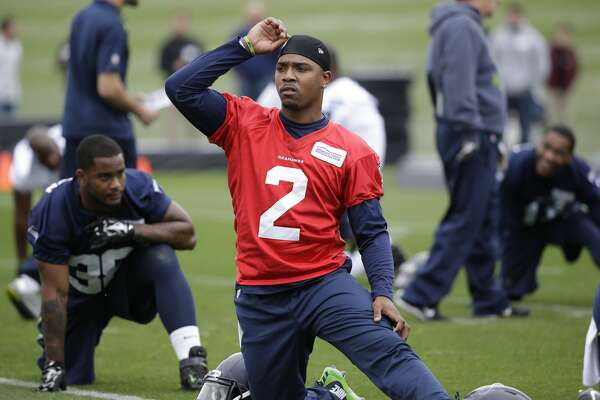 Seattle Seahawks' Trevone Boykin stretches at an NFL football practice Thursday, May 26, 2016, in Renton, Wash. (AP Photo/Elaine Thompson)
