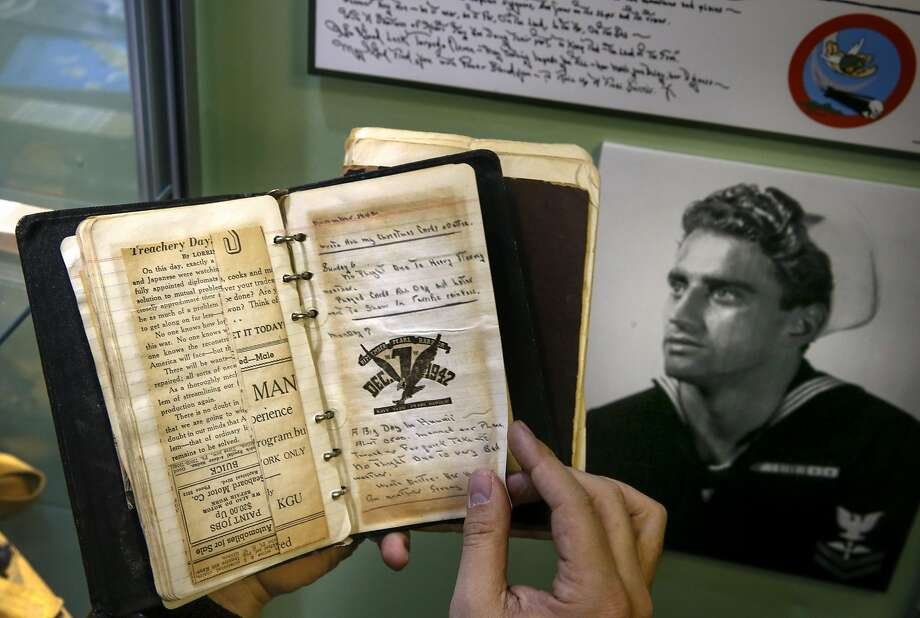 George Retelas looks through the journal of his grandfather (pictured at right). Photo: Michael Macor, The Chronicle