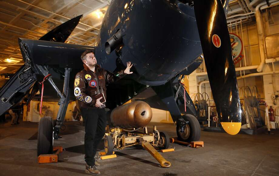 George Retelas stands next to the torpedo bomber his grandfather maintained as a aircraft mechanic during World War II. Photo: Michael Macor, The Chronicle