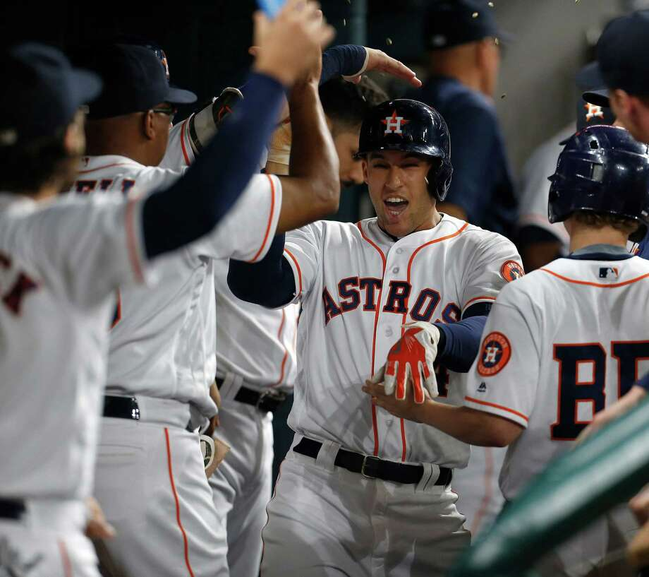 May 26: Astros 4, Orioles 2Houston Astros right fielder George Springer (4) celebrates his home run in the dugout with teammates during the first inning of an MLB baseball game at Minute Maid Park,Thursday, May 26, 2016. Photo: Karen Warren, Houston Chronicle / © 2016 Houston Chronicle