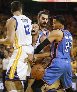 Golden State Warriors� Stephen Curry gets jammed up between teammate Andrew Bogut, and Oklahoma City Thunders� Steven Adams and Andre Roberson in the first quarter during Game 5 of the NBA Western Conference Finals at Oracle Arena on Thursday, May 26, 2016 in Oakland, Calif.