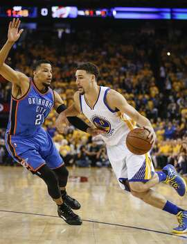 Golden State Warriors� Klay Thompson drives on Oklahoma City Thunders� Andre Roberson in the first quarter during Game 5 of the NBA Western Conference Finals at Oracle Arena on Thursday, May 26, 2016 in Oakland, Calif.
