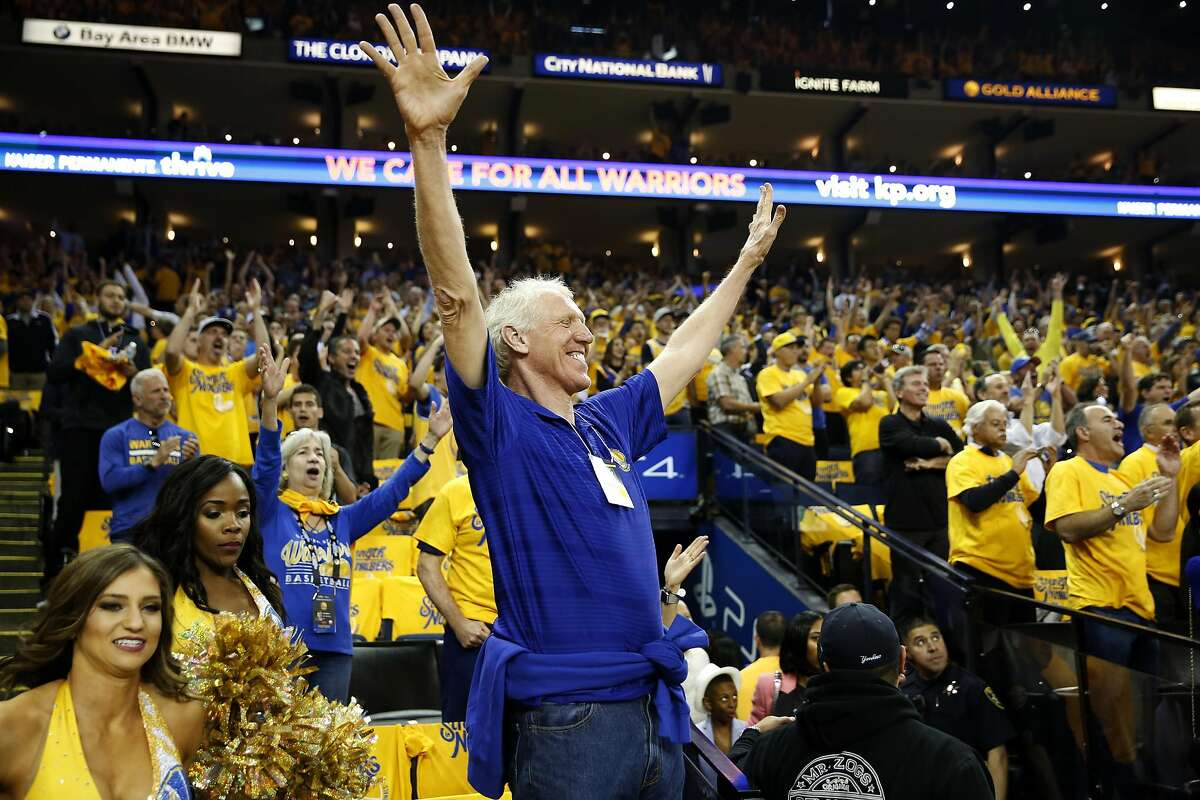 Bill Walton, father of Warriors assistant coach Luke Walton, celebrates with other fans during game five of the Western Conference Finals between the Warriors and the Oklahoma City Thunder in Oakland, California, on Thursday, May 26, 2016.