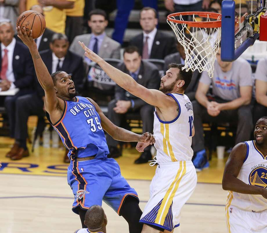 Oklahoma City Thunders' Kevin Durant tries to shoot over Golden State Warriors' Andrew Bogut in the first quarter during Game 5 of the NBA Western Conference Finals at Oracle Arena on Thursday, May 26, 2016 in Oakland, Calif. Photo: Michael Macor, The Chronicle