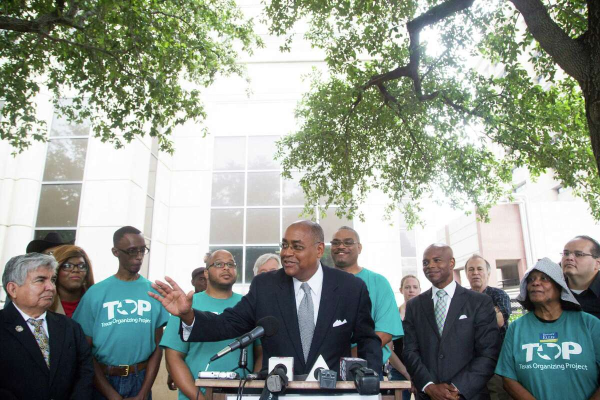 """State Sen. Rodney Ellis, center, joined members of the Texas Organizing Project on Thursday in front of Harris County's 180th State District Court to protest the county's bail practices. Ellis said high bails force many people to be kept """"locked up because they are poor."""""""