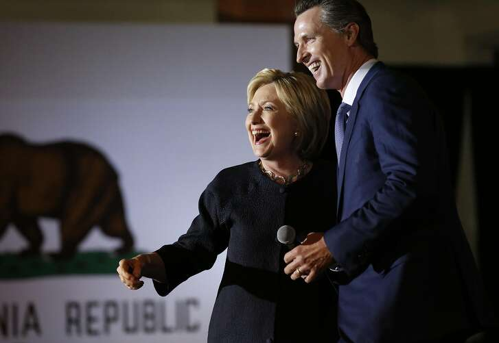 Presidential candidate Hillary Clinton greets Lieutenant Governor Gavin Newsom on stage before giving a speech to supporters during a campaign stop at the Hibernia Bank in the Tenderloin May 26, 2016 in San Francisco, Calif.