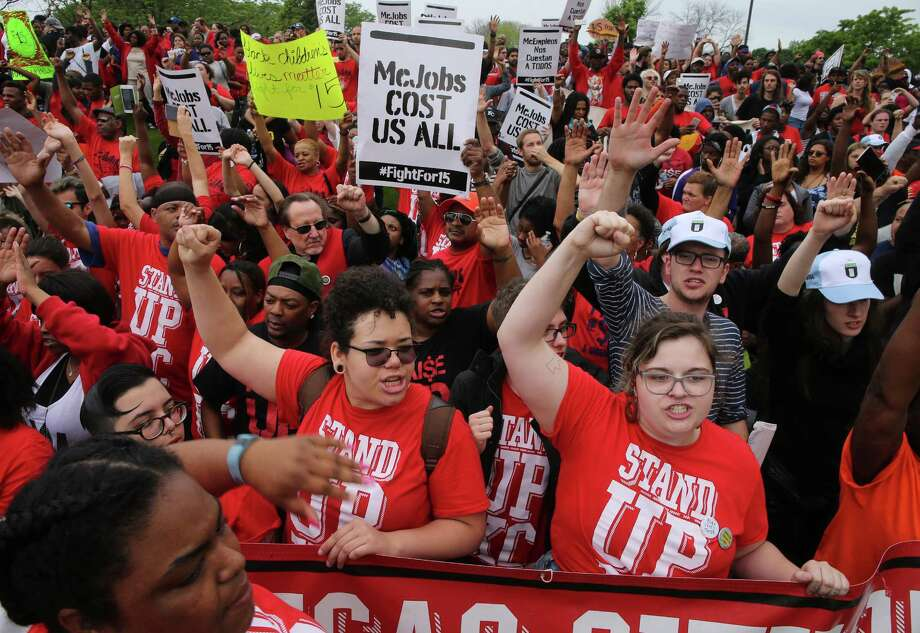 Protesters converge at the McDonald's campus along Jorie Boulevard, Thursday, May 26, 2016, in Oak Brook, Ill., to rally for a $15 per hour work wage during the annual shareholders meeting. (Antonio Perez/Chicago Tribune via AP) Photo: Antonio Perez, MBO / Chicago Tribune