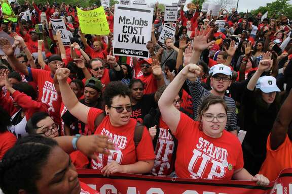 Protesters converge at the McDonald's campus along Jorie Boulevard, Thursday, May 26, 2016, in Oak Brook, Ill., to rally for a $15 per hour work wage during the annual shareholders meeting. (Antonio Perez/Chicago Tribune via AP)