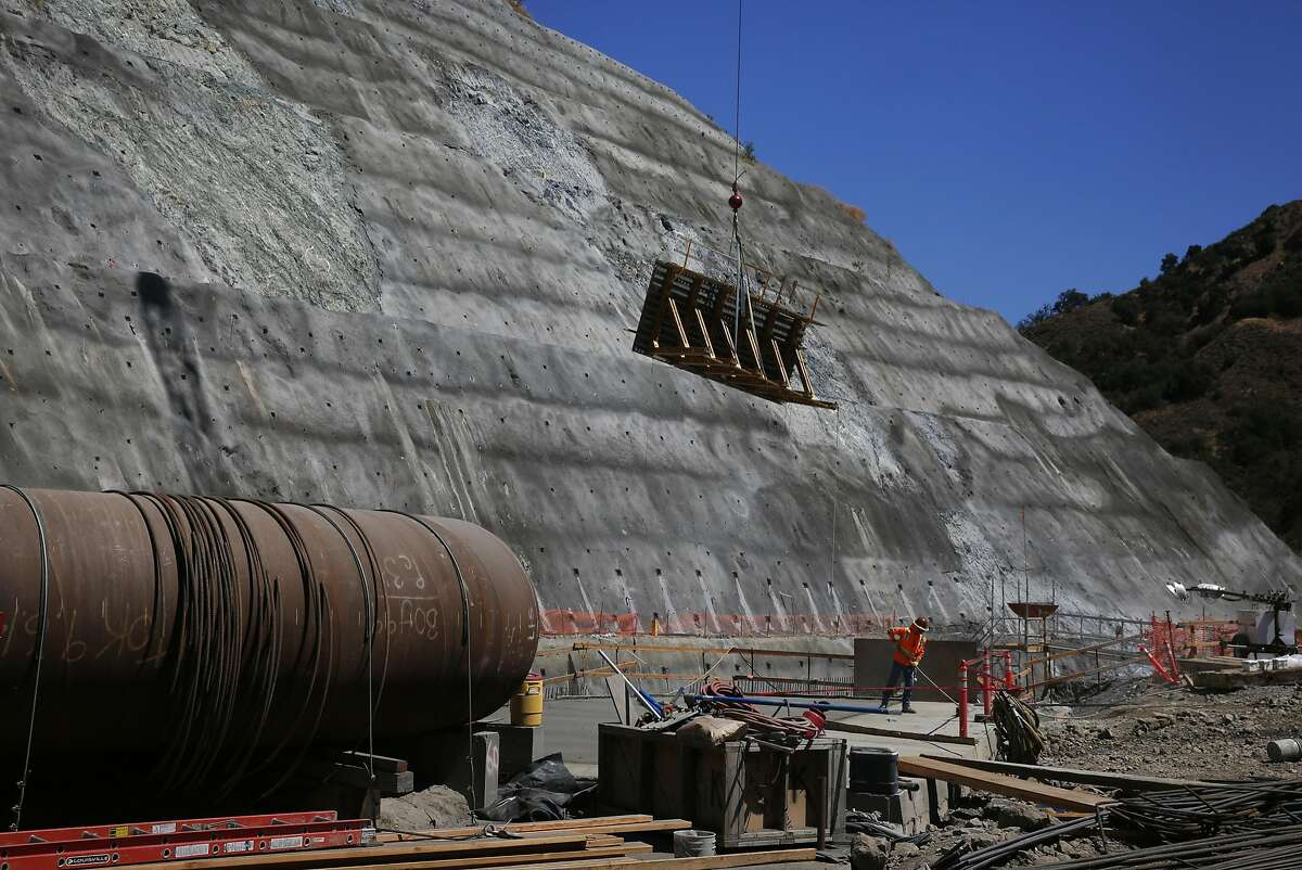 Russ Pryor sweeps the ground at the Calaveras Dam replacement project August 12, 2015 near Fremont, Calif. SFPUC is replacing the dam to meet new zoning requirements for earthquakes along the Calaveras Fault.