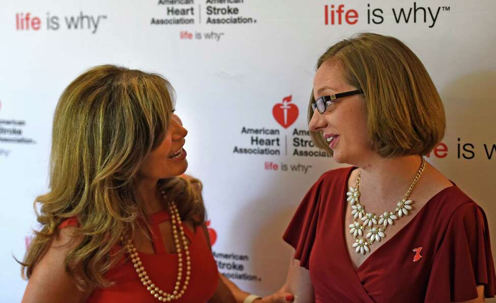 Maria Decker, board member of the American Heart Association, left meets stroke victim Alison Gilcreast of Ballston Spa at the Go Red for Women luncheon Thursday morning May 26, 2016, in Colonie, N.Y. The Go Red for Women program in association with the American Heart Association is designed to make women more aware of heart attacks in women. (Skip Dickstein/Times Union)