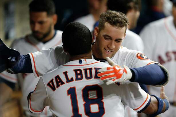 Houston Astros right fielder George Springer (4) hugs Luis Valbuena after his second home run of the game in the fifth inning of an MLB baseball game at Minute Maid Park,Thursday, May 26, 2016.