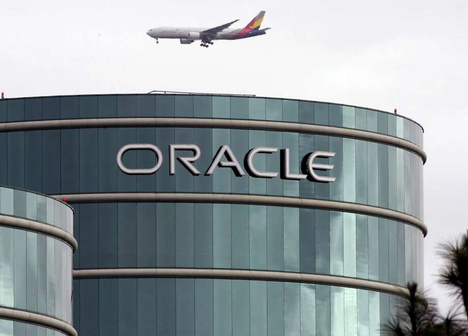 FILE - In this Tuesday, March 20, 2012, file photo, a plane flies over Oracle headquarters in Redwood City, Calif. On Thursday, May 26, 2016, a federal jury sided with Google in a long-running legal battle with tech industry rival Oracle in a complex copyright case that was closely watched in Silicon Valley. Oracle had said Google stole some of its software to create Android, the world's most popular smartphone operating system. Oracle is vowing to appeal. (AP Photo/Paul Sakuma, File) Photo: Paul Sakuma, STF / Copyright 2016 The Associated Press. All rights reserved. This material may not be published, broadcast, rewritten or redistribu