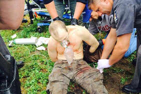 Police photo obtained by Bob Lonsberry showing David Sweat receiving first aid after being shot and apprehended Sunday afternoon, June 28, 2015, near the Canadian border in the Town of Constable, N.Y. (Courtesy)