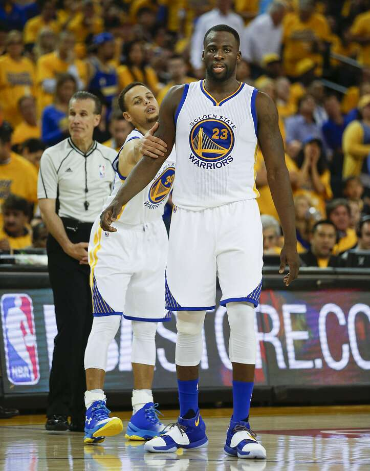 Draymond Green is restrained by Stephen Curry in the third quarter of Game 5 of the Western Conference finals. Photo: Scott Strazzante, The Chronicle