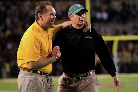 Baylor defensive coach Phil Bennett (left) and head coach Art Briles celebrate in the final seconds against Oklahoma on Nov. 19, 2011, in Waco.