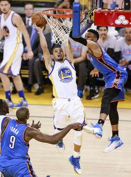 Golden State Warriors� Stephen Curry goes up for a shot against Oklahoma City Thunders� Russell Westbrook in the third quarter during Game 5of the NBA Western Conference Finals at Oracle Arena on Thursday, May 26, 2016 in Oakland, Calif.